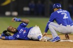 Toronto Blue Jays' Reyes reacts to the pain after hurting his ankle in the sixth inning against the Kansas City Royals at baseball game in Kansas City